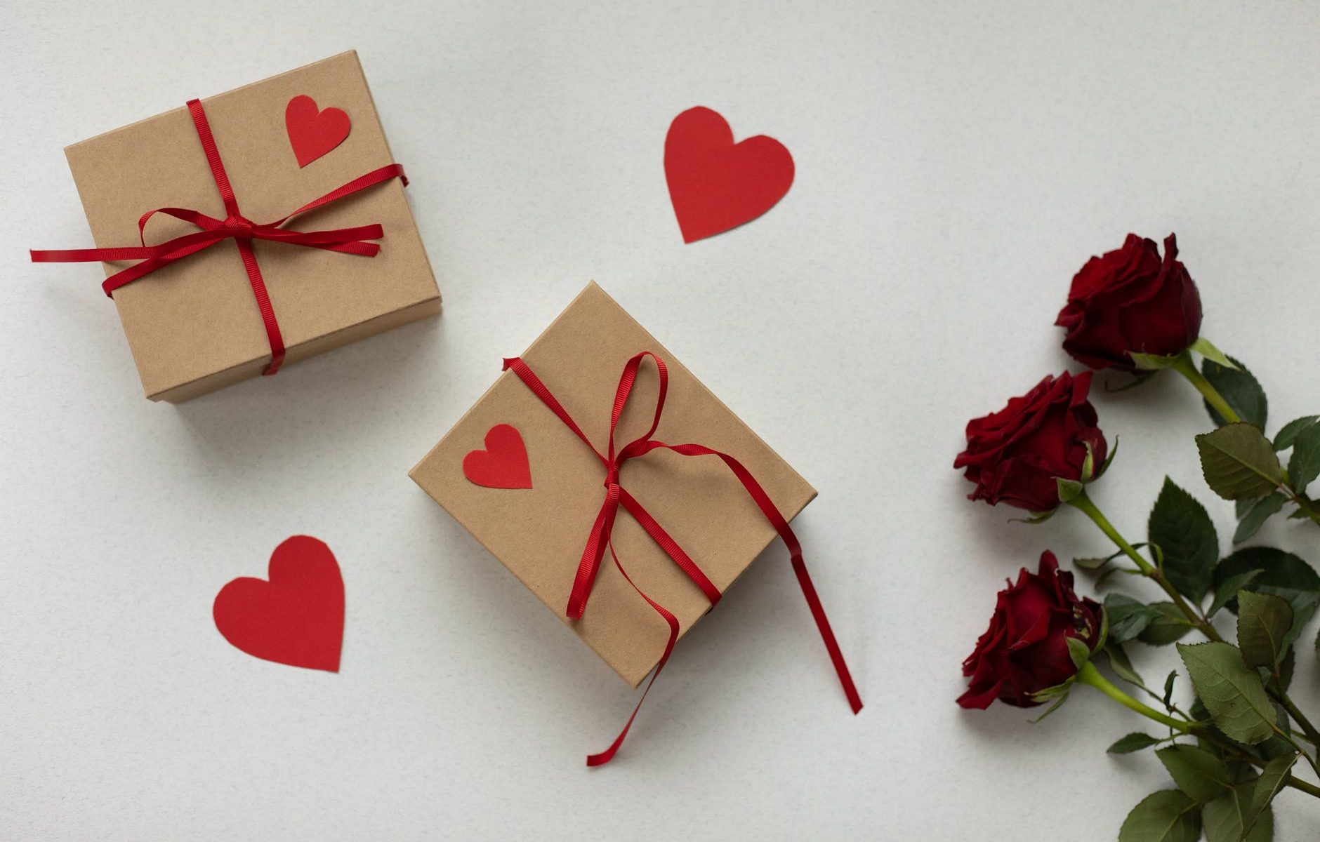 gift boxes on table with roses